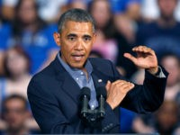 President Barack Obama gestures as he speaks at the University at Buffalo, the State University of New York, Thursday, Aug. 22, 2013 in Buffalo, N.Y., where he began his two day bus tour to speak about college financial aid. (AP Photo/Keith Srakocic)