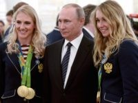 Putin Olympic women (Associated Press)