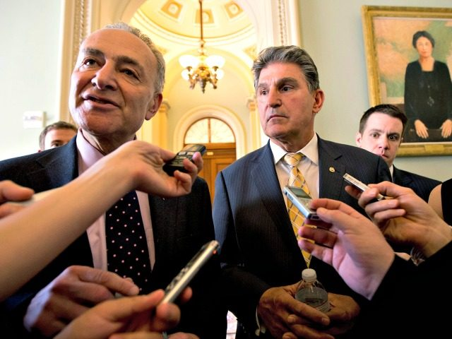 Sens. Chuck Schumer, D-N.Y., left, and Joe Manchin, D-W.Va. speak to reporters as they walk from Senate Majority Leader Harry Reid's, D-Nev., office on Capitol Hill in Washington, Tuesday, April 9, 2013, after a meeting on gun control. Reid's determination to stage a vote came despite continued inconclusive talks between …