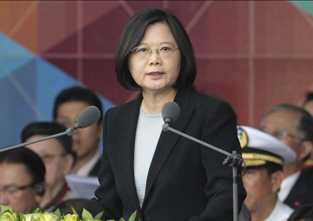 Taiwan President Tsai Ing-wen delivers a speech during National Day celebrations in front of the Presidential Building in Taipei, Taiwan, Monday, Oct. 10, 2016. (AP Photo/Chiang Ying-ying).