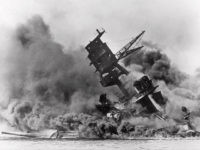 Smoke rises from the battleship USS Arizona as it sinks during a Japanese surprise attack on Pearl Harbor, Hawaii. (AP File Photo)