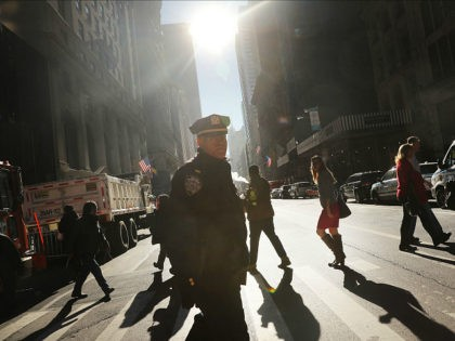 NEW YORK, NY - NOVEMBER 08: Police stand guard near Trump Tower on Election Day on November 8, 2016 in New York City. Throughout the country, millions of Americans are casting their votes today between Hillary Clinton and Donald Trump for the 45th president of the United States. (Photo by …