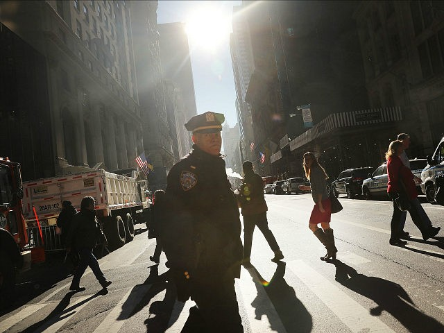 NEW YORK, NY - NOVEMBER 08: Police stand guard near Trump Tower on Election Day on November 8, 2016 in New York City. Throughout the country, millions of Americans are casting their votes today between Hillary Clinton and Donald Trump for the 45th president of the United States. (Photo by Spencer Platt/Getty Images)