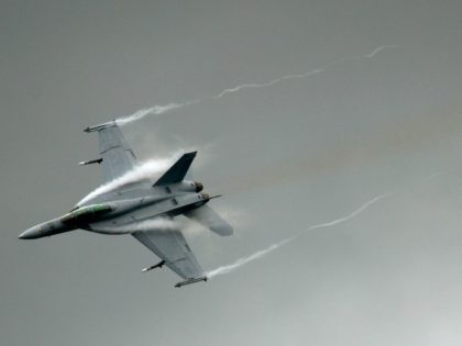 An F-18 takes part in a flying display at the Farnborough International Airshow in Hampshire, southern England, on July 9, 2012. Boeing was set to steal a march over European rival Airbus at the Farnborough airshow which began on Monday, with the US planemaker expected to secure big orders for …