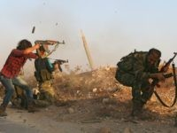 Fighters from the Free Syrian Army take part in a battle against the Islamic State (IS) group jihadists in the northern Syrian village of Yahmoul in the Marj Dabiq area north of the embattled city of Aleppo on October 10, 2016. Syria's main opposition group called for foreign allies to …