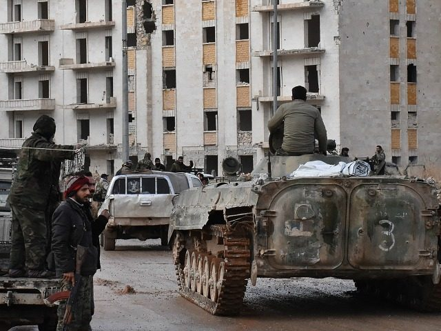 Syrian pro-government forces set up an outpost on December 2, 2016 in the Aleppo's eastern neighbourhood of Sakan al-Shababi after they retook from rebel fighters. President Bashar al-Assad's forces captured Aleppo's northeast this week and were focused on seizing Sheikh Saeed, a large district on the city's southeast edges. The …