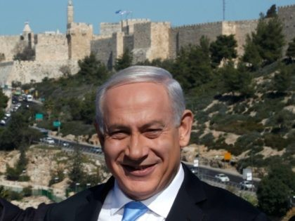 Backdropped by Jerusalem's Old City walls, Israeli Prime Minister Benjamin Netanyahu speaks to the press during a visit to the Begin Heritage center on January 21, 2013. With less than 24 hours until Israelis vote in general elections, party leaders were campaigning down to the wire ahead of a ballot …