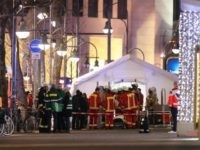 Security and rescue workers tend to the scene after a lorry truck ploughed through a Christmas market on December 19, 2016 in Berlin, Germany. At least two people have died as police investigate the attack and whether it is linked to a terrorist plot.