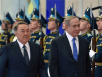 Kazakh President Nursultan Nazarbayev (L) and Israeli Prime Minister Benjamin Netanyahu (R) inspect honour guards during their meeting in Astana on December 14, 2016. Netanyahu is on an official visit to Kazakhstan. / AFP / ILYAS OMAROV (Photo credit should read ILYAS OMAROV/AFP/Getty Images)
