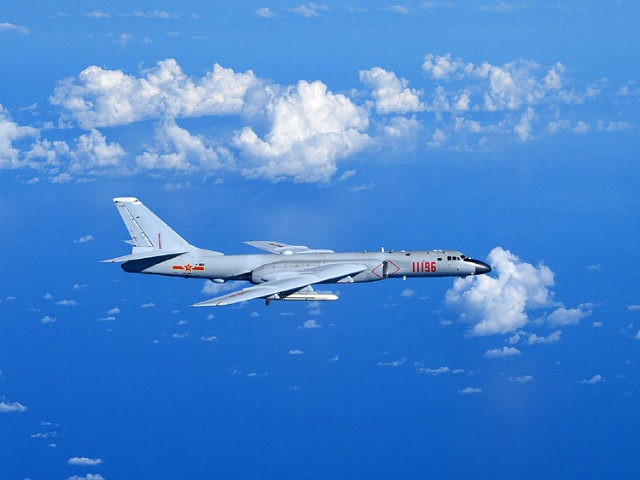 GUANGZHOU, Sept. 13, 2016 -- A Chinese Air Force H-6K bomber flies to the West Pacific, via the Bashi Strait, for a routine combat simulation drill, Sept. 12, 2016. The Chinese Air Force on Monday sent multiple aircraft models, including H-6K bombers, Su-30 fighters, and air tankers, for the drill. …