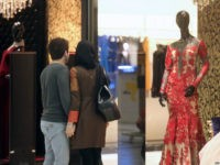 An Iranian couple look at a window display of a shop selling women's clothes at the Laleh Park shopping center in Tabriz in Iran's northwestern East-Azerbaijan province on October 15, 2014. AFP PHOTO /ATTA KENARE (Photo credit should read ATTA KENARE/AFP/Getty Images)