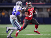 Doug Martin of the Tampa Bay Buccaneers carries the ball during the first half against the Dallas Cowboys at AT&T Stadium on December 18, 2016