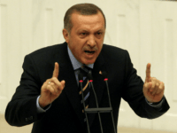 Turkey's Prime Minister Recep Tayyip Erdogan addresses the members of parliament during a debate at the Turkish Parliament in Ankara, on November 13, 2009. Turkey's parliament is set to discuss details of a plan to give wider rights to Kurds, including allowing them to restore Kurdish names to their towns. …