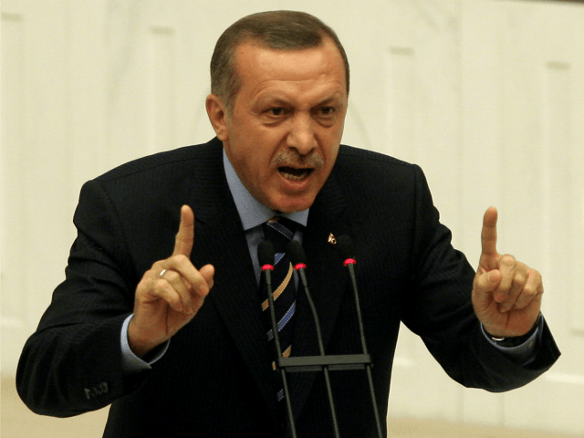 Turkey's Prime Minister Recep Tayyip Erdogan addresses the members of parliament during a debate at the Turkish Parliament in Ankara, on November 13, 2009. Turkey's parliament is set to discuss details of a plan to give wider rights to Kurds, including allowing them to restore Kurdish names to their towns. The measures, aimed at getting the outlawed Kurdistan Workers' Party (PKK) to lay down arms, are part of a 'democratic opening' plan for the benefit of the country's estimated 12 million Kurds. AFP PHOTO/ADEM ALTAN (Photo credit should read ADEM ALTAN/AFP/Getty Images)