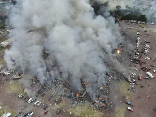 This image made from video provided by APTN, shows a view from a drone of smoke billowing from the San Pablito Market, where an explosion ripped through a fireworks market in Tultepec, Mexico, Tuesday, Dec. 20, 2016. Sirens wailed and a heavy scent of gunpowder lingered in the air after …
