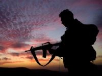 In this photo distributed by the IDF February 8, 2003, an Israeli army paratrooper stands guard at sunrise during a brigade-wide exercise in northern Israel. For the part week, the elite paratroopers brigade has held a large-scale exercise as it takes a break from more than two years of intensive …