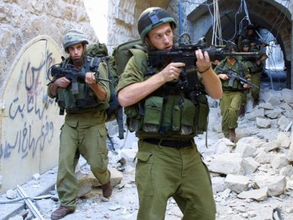 Israeli soldiers patrol 27 August 2003 the old quarter of the West Bank city of Nablus, walking over the debris of a destroyed suspected Islamic Jihad bomb-making factory. According to the army, a large amount of explosive material and a ready bomb were found at the site before it was …