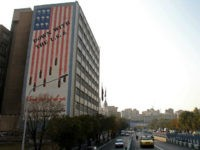 A general view shows a building bearing anti-US graffiti in the Iranian capital Tehran on November 9, 2016. Iran's President Hassan Rouhani said there was 'no possibility' of its nuclear deal with world powers being overturned by US president-elect Donald Trump despite his threat to rip it up. / AFP …