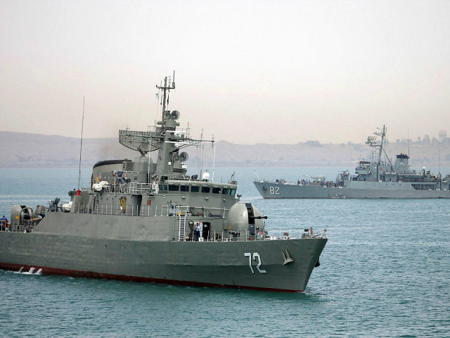 In this picture taken on Tuesday, April 7, 2015, and released by the semi-official Fars News Agency, Iranian warship Alborz, foreground, prepares before leaving Iran's waters. Iran dispatched a naval destroyer and another logistic vessel, Wednesday to waters near Yemen as the United States quickened weapons supply to the Saudi-led …