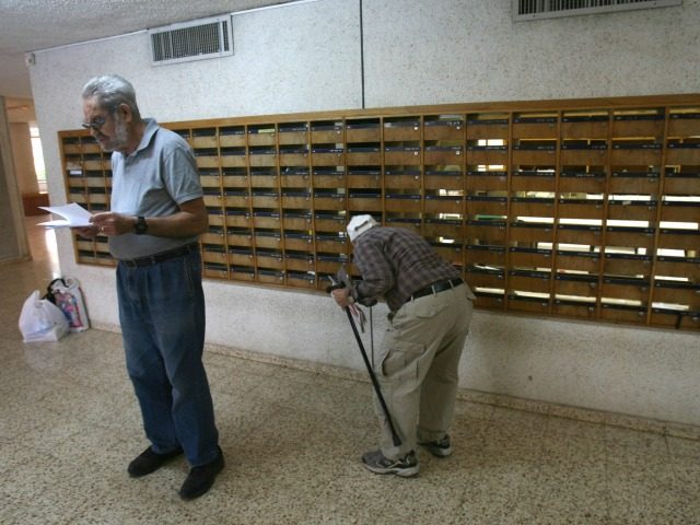 Residents of Israel's oldest kibbutz, Deganya Alef, on the shores of the Sea of Galile check their mail on April 1, 2008. Much has changed in the northern Israeli kibbutz, founded in Ottoman Palestine in 1910 by a group of young and idealistic east European Jews. The socialist ideals that …