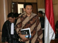Jakarta Governor Basuki Tjahaja Purnama (2nd L), popularly known as 'Ahok', arrives at the court room before his trial for blasphemy at the North Jakarta District Court in Jakarta on December 13, 2016. Jakarta's Christian governor choked back tears on December 13 as he gave an impassioned defence against charges …
