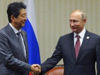 LIMA, PERU - NOVEMBER 19, 2016: Japan's Prime Minister Shinzo Abe (L) and Russia's President Vladimir Putin shake hands at a meeting on the sidelines of the 2016 Asia-Pacific Economic Cooperation summit, at the Swissotel Lima. Mikhail Klimentyev/Russian Presidential Press and Information Office/TASS (Photo by Mikhail Klimentyev\TASS via Getty Images)
