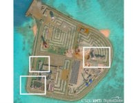 A satellite image shows what CSIS Asia Maritime Transparency Initiative says appears to be anti-aircraft guns and what are likely to be close-in weapons systems (CIWS) on the artificial island Johnson Reef in the South China Sea in this image released on December 13, 2016. Courtesy CSIS Asia Maritime Transparency …