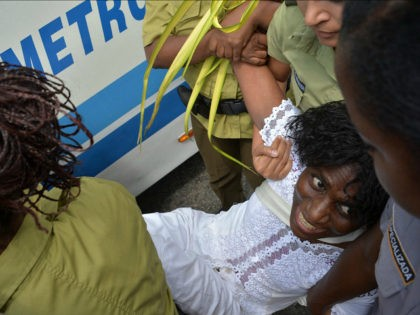 A member of the Ladies in White Human Rights organization is arrested during a march on March 20, 2016 in Havana. Dissidents called on the eve of the visit for US President Barack Obama to promote 'radical change,' notably a 'stop to repression and use of physical violence against all …