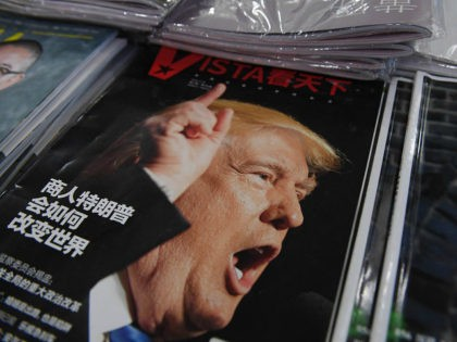 A magazine featuring US President-elect Donald Trump is seen at a bookstore in Beijing on December 12, 2016. The headline reads 'How will businessman Trump change the world'. Beijing is 'seriously concerned' by US president-elect Donald Trump's suggestion that he could drop Washington's One China policy unless the mainland makes …