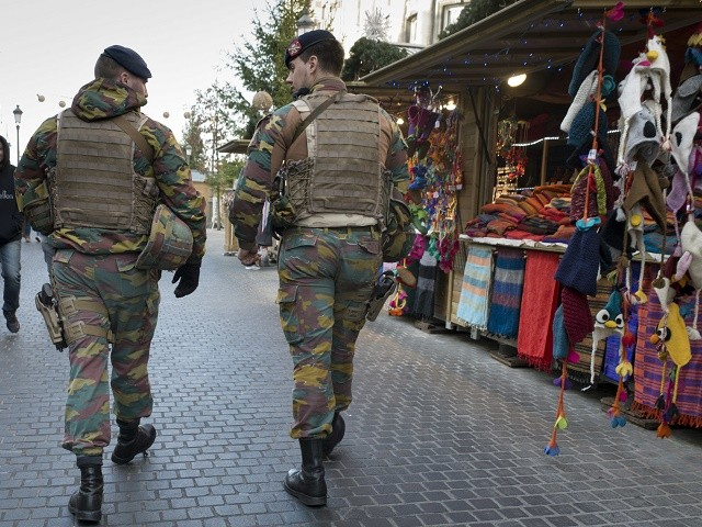 Two Belgian Army soldiers patrol a Christmas market on the main square in Antwerp, Belgium on Tuesday, Dec. 20, 2016, the day after a truck ran into a crowded Christmas market and killing people Monday evening in Berlin, Germany. (AP Photo/Virginia Mayo)