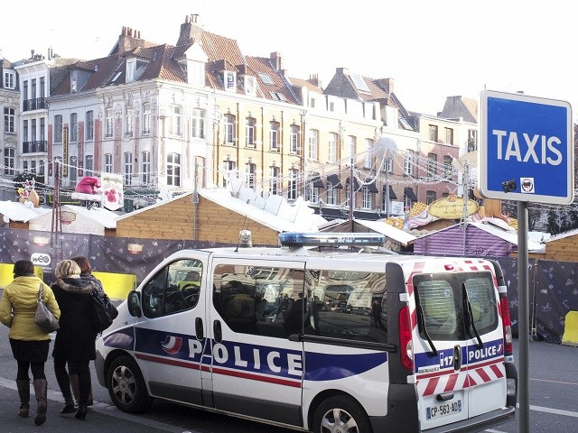 Police stands next to the Christmas market in Lille, northern France, Tuesday, Dec. 20, 2016, the day after a truck ran into a crowded Christmas market killing a number of people Monday evening in Berlin, Germany. (AP Photo/Michel Spingler)