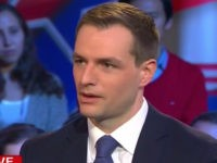 Clinton Campaign Manager Accuses Breitbart of 'Peddling' False News
