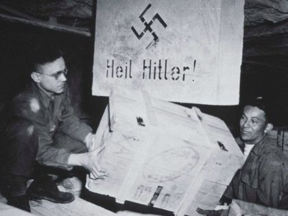 US soldiers unload acrates of art taken from jews by the Nazi's and stored in the Heilbron Salt Mines in Germany May 3, 1945.