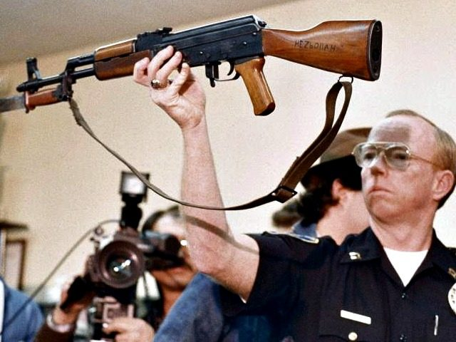 officer holds long gun-AP