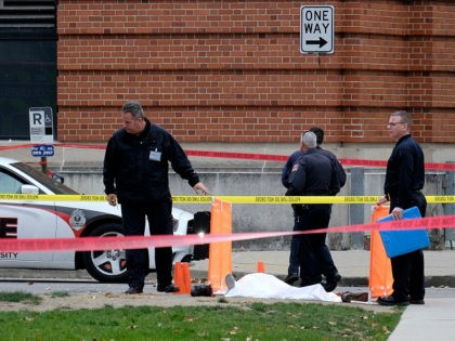 Police cover the body of a suspect outside Watts Hall on the campus of Ohio State University in Columbus, Ohio, following an attack on campus that left several people injured on Monday, Nov. 28, 2016. The man, identified as Abdul Razak Ali Artan, plowed his car into a group of …