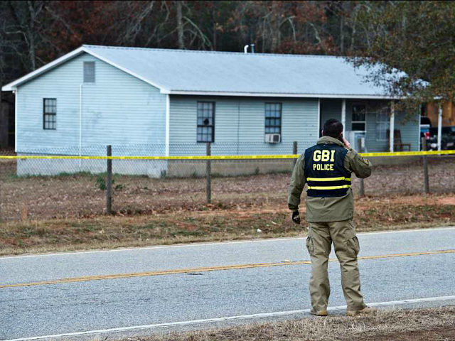 Georgia Bureau of Investigation Special Agent in Charge J.T. Ricketson works at a scene of a shooting involving multiple officers while serving a search warrant at a home in Crawford County, Ga., Monday, Dec. 12, 2016. Authorities said the suspect in the shooting at the home has died. (Woody Marshall/The …