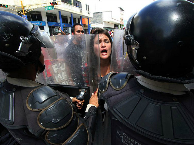Students demonstrate against the government of Venezuelan President Nicolas Maduro in the streets of San Cristobal, in the Venezuelan border state of Tachira, close to Colombia, on November 3, 2016. Venezuela's opposition began a tense truce on Wednesday with President Nicolas Maduro, but supporters accused it of betraying them amid warnings the strategy might backfire. With Pope Francis's blessing, Maduro and top opposition leaders have agreed to sit down to Vatican-mediated talks starting November 11, seeking an exit from a nasty political crisis and economic melt-down. But not everyone is on board. / AFP / GEORGE CASTELLANOS (Photo credit should read GEORGE CASTELLANOS/AFP/Getty Images)