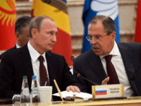 Russian President Vladimir Putin (L) speaks with Russian Foreign Affairs Minister Sergei Lavrov on October 10, 2014 during the Commonwealth of Independent States (CIS) leaders summit in Minsk. AFP PHOTO / POOL / ALEKSEY NIKOLSKY (Photo credit should read ALEKSEY NIKOLSKYI/AFP/Getty Images)