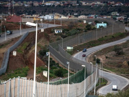 MELILLA, SPAIN - JANUARY 22: A general view of the border fence that limits Morocco from the Spanish enclave of Melilla on January 22, 2015 in Melilla, Spain. According to Spanish Police approximately 2,400 from the 5,000 immigrants entering Melilla last year were Syrians seeking asylum in various European countries. …