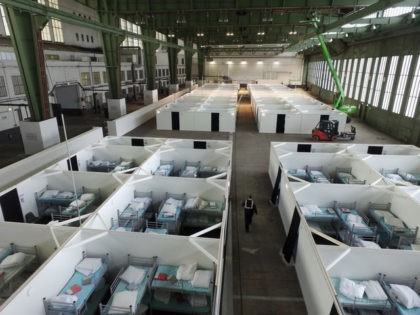 BERLIN, GERMANY - FEBRUARY 11: In this aerial view cubicles furnished with bunk beds stand ready to accommodate refugees and asylum applicants in Hangar 6 of former Tempelhof Airport on February 11, 2016 in Berlin, Germany. Tempelhof, once an airport in the city center and first built in the 1930s, …
