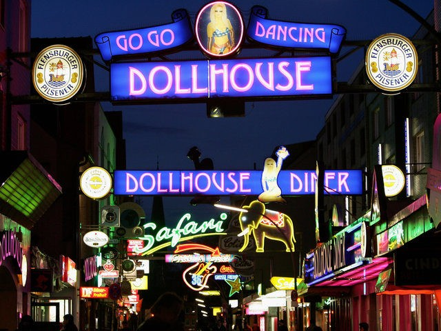 """HAMBURG, GERMANY - APRIL 20: Many clubs and dance bars are see at """"Grosse Freiheit"""" April 20, 2005 near the Reeperbahn in St. Pauli's Red Light district in Hamburg, Germany. Prostitution in Hamburg is being used as an example of the effects of thousands of tourist visas, which were given …"""