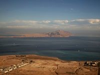 A picture taken on January 14, 2014 through the window of an airplane shows the Red Sea's Tiran (foreground) and the Sanafir (background) islands in the Strait of Tiran between Egypt's Sinai Peninsula and Saudi Arabia. Saudi King Salman on April 11, 2016 wrapped up a landmark five-day visit to …