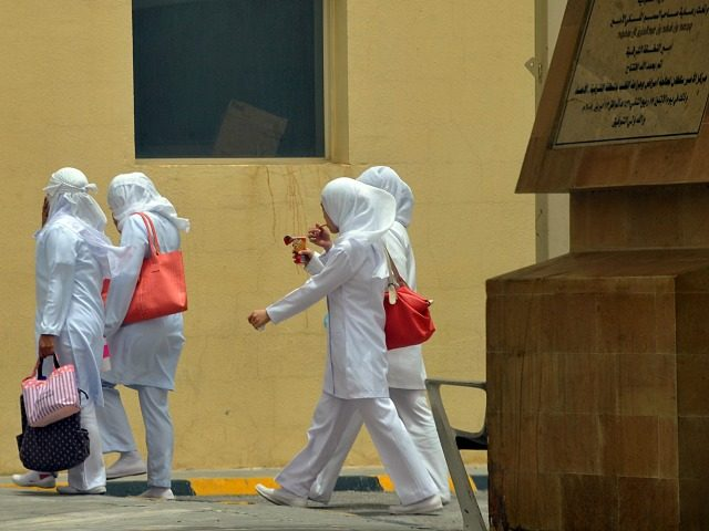 Asian staff nurses walk towards the King Fahad hospital in the city of Hofuf, 370 kms East of the Saudi capital Riyadh, on June 16, 2013. Four people have died from the MERS virus in Saudi Arabia, bringing the death toll from the SARS-like virus in the kingdom to 32, …