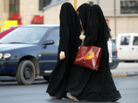 Saudi women walk out of a shopping mall as they wait for their driver to pick them up in Riyadh 14 June 2005. Saudi women hope to follow in the footsteps of counterparts in neighboring Kuwait, where women were granted full political rights and a woman minister was appointed. Saudi officials have so far spoken of granting women the right to vote in the next municipal elections in four years time. AFP PHOTO/HASSAN AMMAR (Photo credit should read HASSAN AMMAR/AFP/Getty Images)
