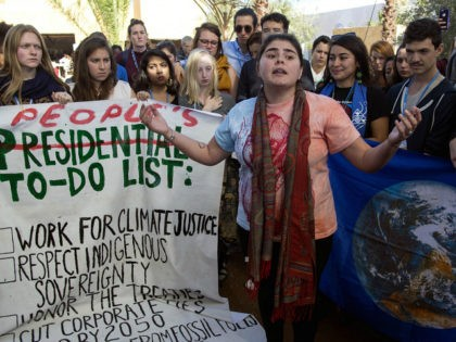 American students protest outside the UN climate talks during the COP22 international climate conference in Marrakesh in reaction to Donald Trump's victory in the US presidential election, on November 9, 2016. Stunned participants at UN climate talks in Marrakesh insisted that climate change denier Donald Trump cannot derail the global …