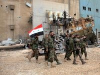 Syrian government forces check Aleppo's thermal power plant after they re-took control of the area on eastern outskirts of Syria's northern embattled city of Aleppo from IS group fighters on February 21, 2016. In two days Syrian government forces have taken more than a dozen villages from IS jihadists around …