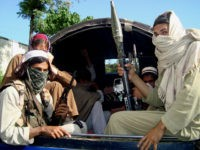 FILE - In this April 24, 2009 picture, Pakistani Taliban leave Buner, Pakistan. Coordinated attacks - along with threats to women, shops selling CDs and barbers - suggest that the Taliban are bleeding out of their traditional havens in the Northwest Frontier Province into Pakistan's Punjab heartland, home to more …