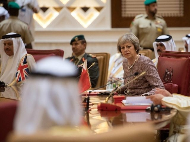 British Prime Minister, Theresa May, attends a plenary session on the second day of the Gulf Cooperation Council summit, on December 7, 2016 in Manama, Bahrain. Prime Minister May is meeting Gulf leaders during the annual two-day Gulf Cooperation Council where she has discussed regional issues including the situations in …