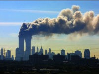 FILE - In this Sept. 11, 2001 file photo, as seen from the New Jersey Turnpike near Kearny, N.J., smoke billows from the twin towers of the World Trade Center in New York after airplanes crashed into both towers. Saudi Arabia and its allies are warning that legislation allowing the …