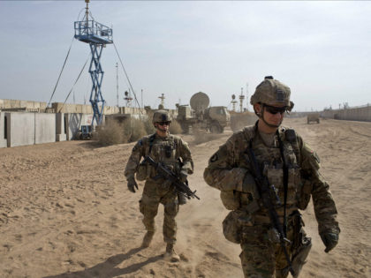 U.S. Army soldiers move through Qayara West Coalition base in Qayara, some 50 kilometers south of Mosul, Iraq, Wednesday, Nov. 9, 2016. Kurdish peshmerga forces continued their push on the town of Bashiqa, some 13 kilometers (8 miles) northeast of Mosul. The town is believed to be largely deserted except …